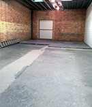 Empty warehouse/delivery room, bricks, ladder (1944 x 2592)